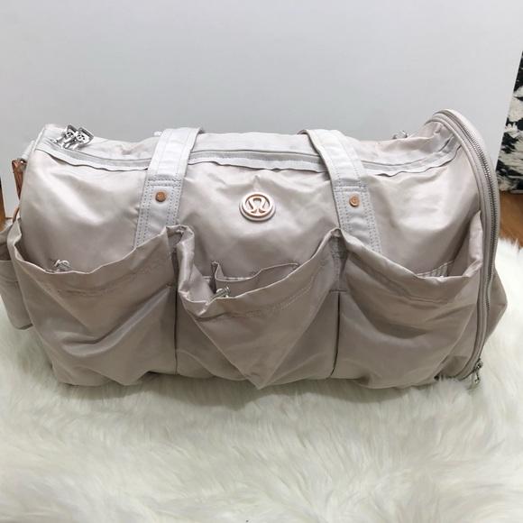 f7cba7b1389 lululemon athletica Handbags - Lululemon Legendary Duffel Bold Blossoms Dune
